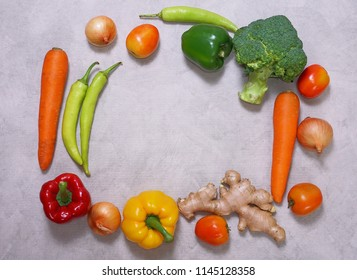 Topview fresh vegetables  tometos and carot and green chilli and bell peper on the marble table, healthy concept.