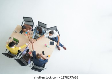 topview of grop creative meeting team  putting their hands together on white floor and copy space
