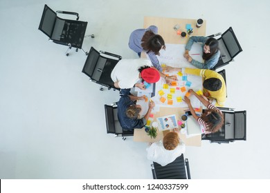 topview of grop creative meeting team work on white floor and copy space