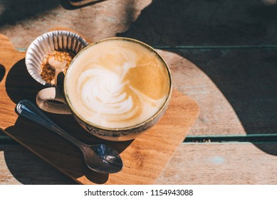Topview of Hot coffee on wood table.vintage tone.