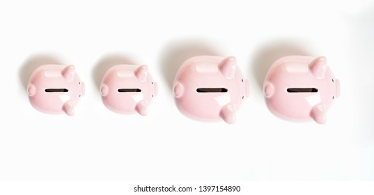 topview of piggy bank or piggybank family - financial growth or capital gain concept