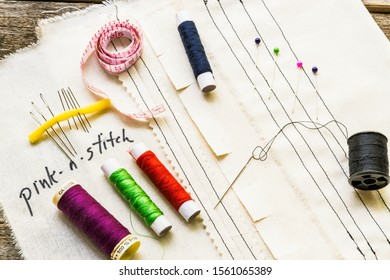 Topview of sewing supplies and stitches on cloth