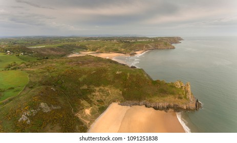 Tor Bay and The Great Tor Aerial view of Tor Bay and The Great Tor on the Gower peninsula, Swansea, South Wales, UK