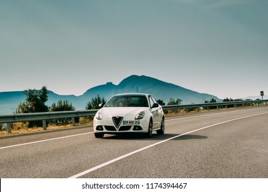 Tor, Girona, Spain - May 17, 2018: Alfa Romeo Giulietta Car Of White Color In Spanish Motorway.