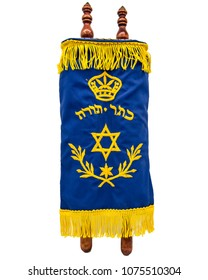 Torah five books of Moses. In Hebrew it says crown of the Torah (five books of Moses)