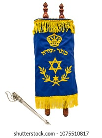 Torah five books of Moses with pointer (Yad) that is used to read the Torah . In Hebrew it says crown of the Torah (five books of Moses)