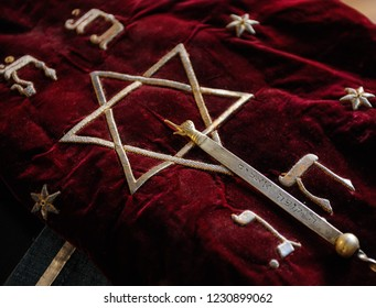 Torah scrolls in a purple case with Hebrew symbols. Torah is used in synagogues especially during the Juwish holidays.