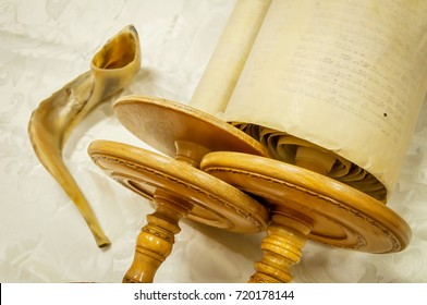 "Torah scrolls and a ""shofar"" musical horn, both used in the Judaism religious services in a synagogue. Torah sefer book megillah Judaism prayer."