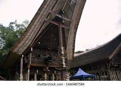 Toraja, Indonesia - July 14, 2019; Tongkonan house with a buffalo horn roof as a traditional house of the Toraja tribe in Sulawesi. one of the tribes that can award world heritage from Uniesco