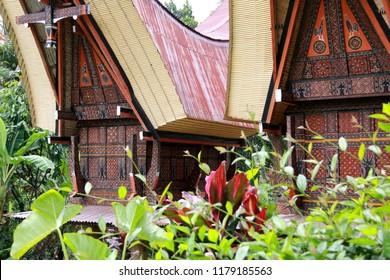 Toraja, Sulawesi, Indonesia - February 4th 2018: Tongkonans, traditional Toraja houses with massive peaked-roofs