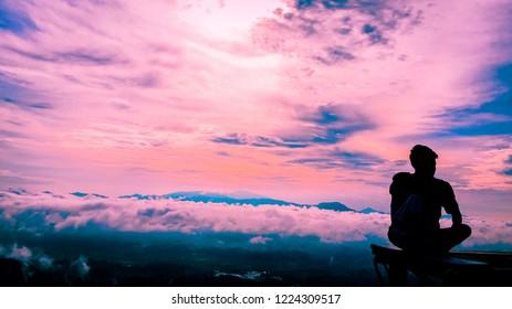 Toraja, Sulawesi, Indonesia; Nov 6, 2018; a man sitted to see beautiful sunrise at Negeri atas awan, Lolai, Toraja, Sulawesi, Indonesia.