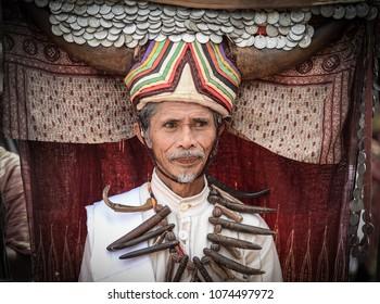 Toraja, Sulawesi Selatan / Indonesia - December 28th 2017: The elder of   Tana Toraja tribe wear traditional costume with buffalo shaped head dress during annual event Toraja Lovely December.