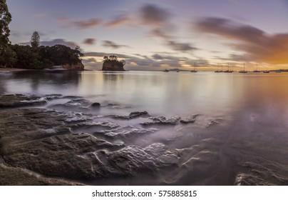 Torbay Tor at Waiake Beach Auckland Beach, New Zealand at Dawn.
