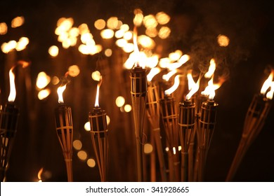 torches at night with yellow flames and highlights