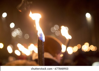 Torchlight procession flames, Edinburgh, Scotland