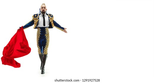 Torero in blue and gold suit or typical spanish bullfighter isolated over white studio background. The taming, achieving the goal, mortification, conquest, boss, leadership, battle, win, winner