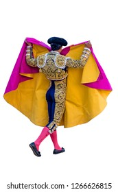 Torero in blue and gold suit and wearing montera raising his capote with his hands over shoulders in a typical spanish bullfight isolated over white