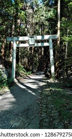 "Torii, the entrance gate to Amano Iwato Shrine in Mie Prefecture, Japan. (The sign in the middle of the torii is the name of this shrine, ""Amano Iwato"")"