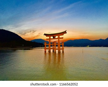 The torii gate of Itsukushima Shrine in Miyajima island, a unesco world heritage site and the temple's most recognizable landmark, appears to float in the water.