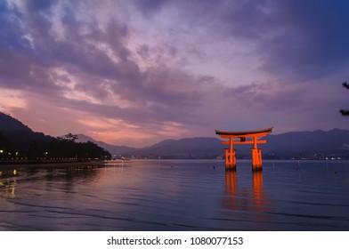 Torii Gate of Itsukushima Shrine on sunset time at Miyajima, Hiroshima, Japan