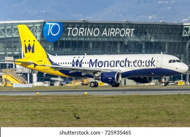 TORINO CASELLE AIRPORT - December 24, 2016. Airbus A320 Monarch landing at Turin Airport. This chareter company based on Luton, near London, is failed the October 2 2017. Airline ceases trading