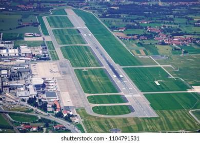 TORINO CASELLE AIRPORT, ITA- JUNE 2018: Turin airport runway top view.