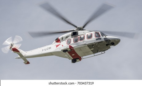 TORINO CASELLE AIRPORT - July 17, 2017: One of the first Agusta Westland AW189 model produced by Leonardo-Finmeccanica Helicopters in Italy. Low pass on runway for a flight test.