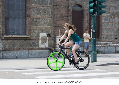 TORINO, ITALY: July 3, 2015: Zeroundici, italian electric bikes moving around in the city