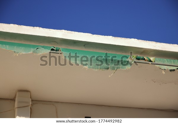 torn-awning-house-tent-ripped-600w-17744