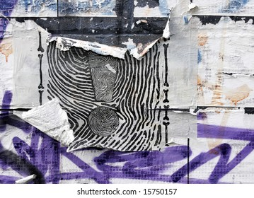 torn billposter and graffiti