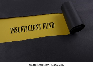 """Torn black paper on yellow surface with """"insufficient fund"""" word. Business concept"""