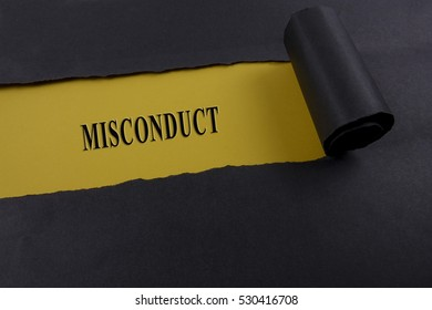 """Torn black paper on yellow surface with """"MISCONDUCT"""" word. Business concept"""