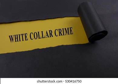 """Torn black paper on yellow surface with """"WHITE COLLAR CRIME"""" word. Business concept"""