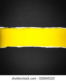 Torn black Paper and space for text with a  yellow paper background