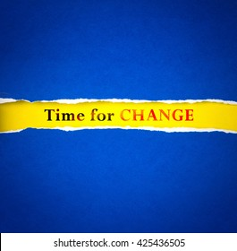 Torn blue Paper and space for text with a  yellow paper background with time for change word