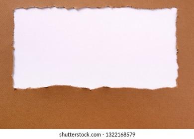 Torn brown paper background frame oblong