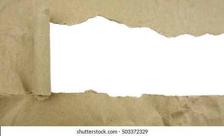 Torn brown paper on white surface