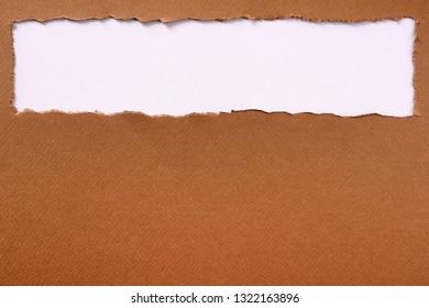 Torn brown paper strip top edge header background frame