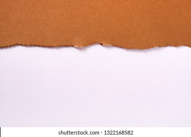 Torn brown paper top edge border white background