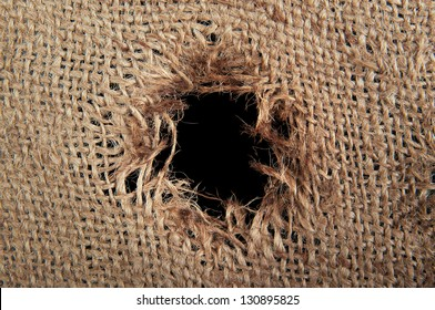 Torn burlap decayed. Ragged linen fabric.