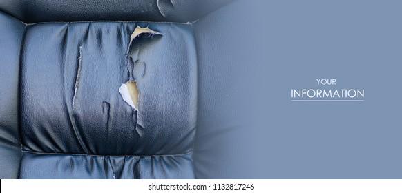 Torn car seat black leather ruptured foam rubber