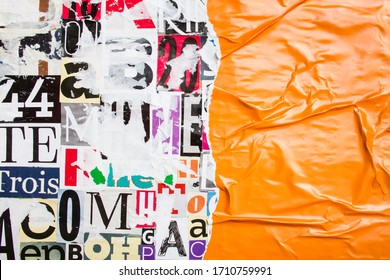 Torn and crumpled orange glossy paper poster on bright colorful collage of magazine paper pieces and clippings with letters and numbers background.