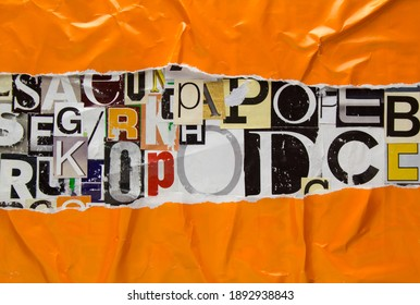 Torn and crumpled orange paper on collage from clippings with newspaper magazine letters and numbers. Ripped orange paper on alphabet letters cutting from magazine. Abstract fashion background.