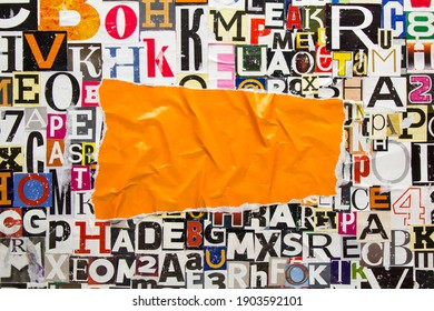 Torn and crumpled piece of orange paper on collage from clippings with newspaper magazine letters and numbers. Creased orange paper on alphabet letters cutting from magazine. Copy space for text.