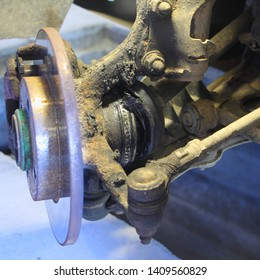 Torn CV joint duster, hub with brake disk and sterering rod - repair car suspension and gear drive