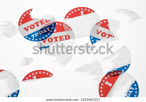 Torn and defaced I Voted Today stickers in aftermath of the US elections isolated on white background
