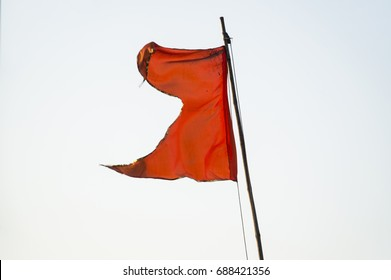 the torn flag blowing on white background