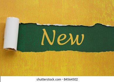 Torn gold paper background with texture with word new, Announcing something new