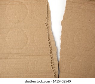 torn in half brown sheet of paper from under the box, a slot in the middle, full frame