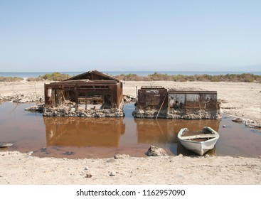 Torn houses in water at Salton Sea beach, California, summer 2007, this site doesn't longer exist.